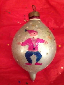 Teardrop-shaped ornament with a cheerful Santa.