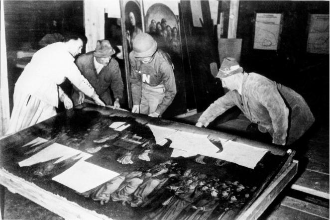 Monuments Man George Stout with the Ghent Altarpiece. Photo credit: National Archives and Records Administration, College Park, MD. Via the Monuments Men Foundation for the Preservation of Art.
