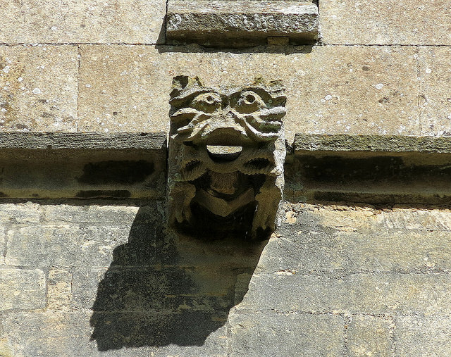 A gargoyle, the Church of St Denys, Aswarby, Lincolnshire, England. Photo by Spencer Means on Flickr (Creative Commons).