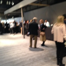 Patrons and dealers mingle at the bar on preview night.
