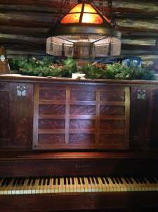 Piano and light fixture at Stickley Museum at Craftsman Farms
