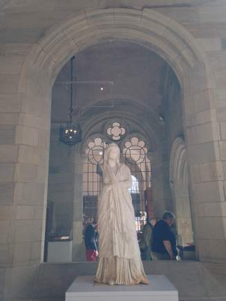 A Roman marble statue of a woman, beautifully framed by an arch at the Yale University Art Gallery.
