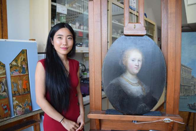 Conservator Shan Kuang with our Rembrandt in NYC